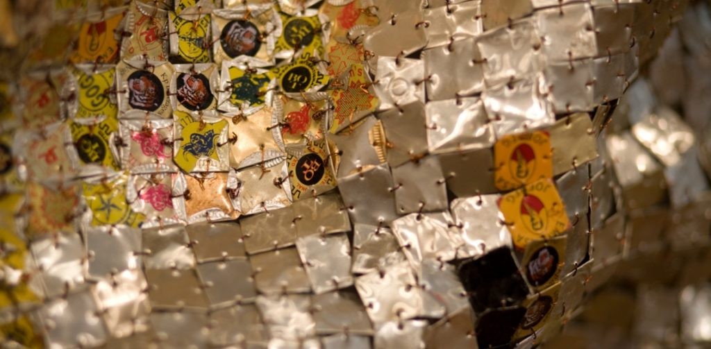 El-Anatsui-Skylines-detail-1-2008.--Aluminium-and-copper-wire-245-x-825cm.-Photo-Jonathan-Greet-Image-courtesy-of-October-Gallery-London.w1140.h560.crop